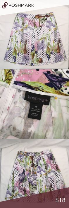 Iris print A line skirt LANE BRYANT floral pastel Excellent condition! Stunning Iris and polkadot print. Unlined, stretch cotton. rear zip closure. 🔹Waist 37 🔹hip 27 🔹length 25 Lane Bryant Skirts A-Line or Full