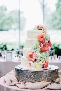 Wedding cake with cascading peonies and roses | Photography: I Love You Too Weddings - www.iloveyoutooweddings.com  Read More: http://www.stylemepretty.com/2014/06/02/modern-art-museum-wedding/