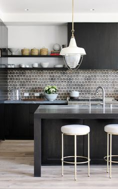 Dark tiled backsplash in kitchen