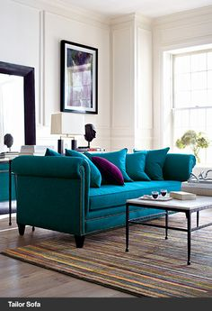 Love the turquoise sofa!