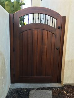 Custom Wood Gate with Decorative Metal Pickets by Garden Passages