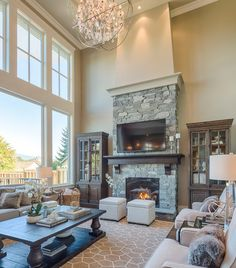Lovely 2 Story House   Complete With Large Living Room With Two Story  Windows, Gorgeous Lighting, Large Area Rug, Stone Fireplace