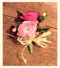 Pink Ranunculus, Hypericum Berries, natural Raffia Bow. Corsage created by Lexington Floral in Shoreview, MN #ranunculus #pinkwedding #rusticwedding #countrywedding #pinkcorsage #lexingtonfloral