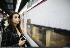 Young woman on train station - stock photo