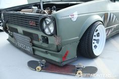 Slammed skateboard under slammed Golf GTI