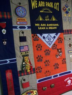 """a quilt to be made with your Scout T Shirts and Uniform pieces. Each quilt made is a one of a kind creation based on your memorabilia. The quilt pictured is a quilted wall hanging measuring approx. 28"""" x 40"""" for the accompanying price. Your quilt can be made using Boy Scout or Girl Scout tee shirts and uniforms, Sports shirts and uniforms, or School Spirit Wear. These quilts are a great way to display pins, patches and awards of all kinds."""