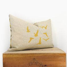 Birds pillow cover -  Decorative throw pillows - Mustard flying birds print on natural canvas with geometric printed back - 12x18 size. $34.00, via Etsy.