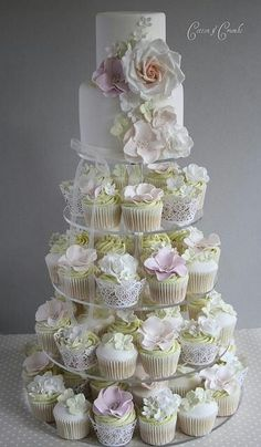 wedding cupcakes... But brighter flowers! Love the small cake at the top with the cupcakes!