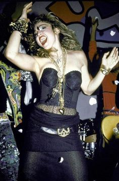 WHO wants to write a research paper on Madonnas fashion? HELP it can be short :)?