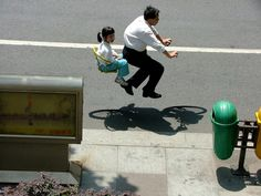Zhao Huasen photographed ordinary travelers on bikes and then removed the cycles, creating these hovering portraits! We love how he chose to leave the bicycles' shadows untouched, which makes these photos much more interesting.