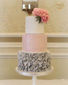 Grey ruffles and pink glitter wedding cake. #weddingcakes