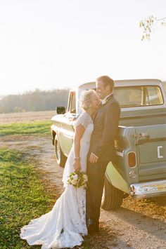 cute wedding picture next to an old truck