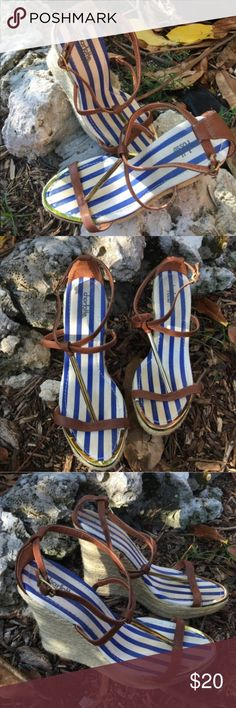 """Charlotte Russe Tan, blue, white gold wedges Charlotte Russe ADORABLE wedges! Straps are tan with goldtone accent bar and toe plate, blue and white coloring upper and wedges are a perfect summer woven staple!! These are so cute and perfect for all your fun summer outfits! Worn once for graduation. 5"""" height EUC ✅I ship same or next day ✅Bundle for discount Charlotte Russe Shoes Wedges"""