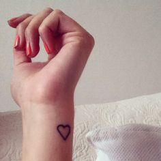 Little heart tattoo on the wrist. Small, simple, but cute.