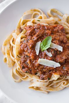 Fettucini Pasta tossed in a Rich, Spicy Italian Sausage & Roasted Garlic Bolognese with Wine and Fresh Basil, topped with Shaved Parmesan Italian Dishes, Italian Recipes, New Recipes, Favorite Recipes, Italian Foods, Italian Pasta, Holiday Recipes, Family Meals, Risotto