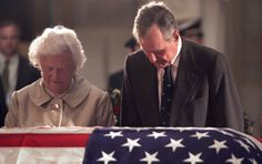 Former PRESIDENT GEORGE H. W. BUSH pays his respects to former running mate  PRESIDENT RONALD REAGAN, alongside his wife, FIRST LADY BARBARA BUSH, at a funeral ceremony held on June 10, 2004, in Washington D.C.