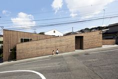 roote angles two-storey family residence on an inclined plot in japan