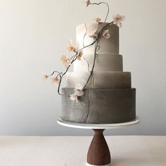 Here's a bigger view of that previous little cake. ... #weddingcake #designerweddingcake #ombre #neutrals #handmadeflowers #ricepaperflowers #crackleeffect #paintedcake #delicatetones @aheirloom