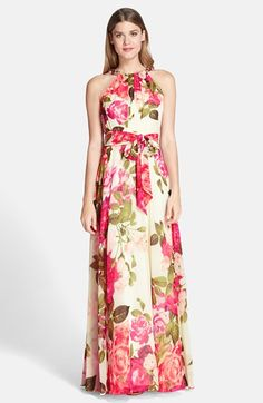 Free shipping and returns on Eliza J Embellished Print Chiffon Gown at Nordstrom.com. Big, rosy flowers inject springtime cheer into the glamorous silhouette of this flowy chiffon gown. The pleated, embellished neckline and tied waist add modern definition.