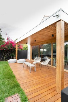 A stunning outdoor area with natiral finished timber. Large stacker slider timber doors. #exterior #decking #landscaping Bathroom Renovations Melbourne, Carpentry Services, Timber Door, Melbourne House, Decking, Oasis, Pergola, Landscaping, Backyard