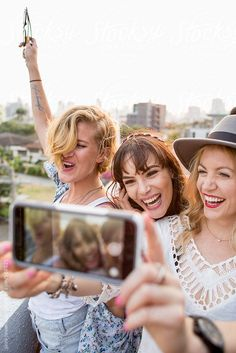 Group of three girlfriends taking a selfie by Jovo Jovanovic