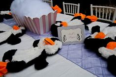 Mary Poppins penguin table; Stuff your own penguin party favor