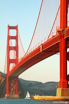 The Golden Gate Bridge carries six lanes over the mile-wide and three-mile long channel between San Francisco Bay and Pacific Ocean.