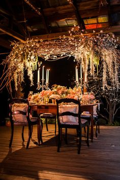 Love this reception set-up, especially the hanging grapevine centerpiece