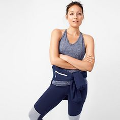 "We partnered with our friends at New Balance to bring you our first-ever collection of workout clothes—in techy fabrics and unique colors and prints. This easy tank top is made from moisture-wicking NB Dry fabric that absorbs sweat (so you can also wear it around after gym class without having to worry). <ul><li>Slightly loose fit.</li><li>Body length: 26"".</li><li>Poly.</li><li>Machine wash.</li><li>Import.</li><li>Select stores.</li></ul>"