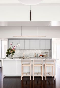 Soft duck blue kitchen in renovated heritage home.