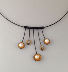 Blue topaz, pearl, 22k gold bimetal, oxidized sterling necklace by Judy Morgan @ www.judyhmorganjewelry.com #judymorgan #judyhmorganjewelry  #pearls #bluetopaz #pearlnecklace #goldbimetal