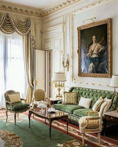 A green sitting room with very French influences.