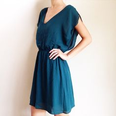 | new | teal dress offers welcome new without tag size large teal green dress with elasticized waist, flowy sleeves, and slit down back. note: has a bit of makeup on internal tag. •971066•  website: xomandysue.com instagram: xomandysue BB Dakota Dresses Mini