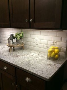 Beveled tile backsplash with quartz