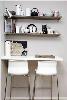fjellby. work desk in kitchen or guest room @Lisa Green something like this on side of window opposite to futon! then expedit shelves... simple, clean...