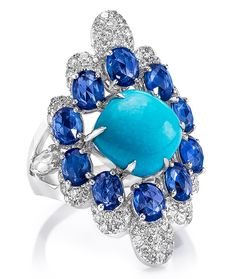 Cabochon Turquoise and Sapphire Ring A 3.77 carat cabochon turquoise is surrounded by 3.62 carats of rose-cut oval sapphires, and detailed with 1.26 carats of round brilliants. Set in 18-karat white gold. $9,450.