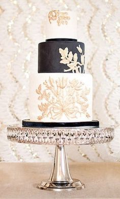 This wedding cake makes me 95% sure that Gold, Black, & White will be my wedding colors