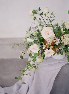 summer inspired wedding flowers, green, white, pale pink blooms with bits of fruit.