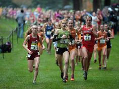 Katie Rainsberger (52) wins the girls race in 16:56 during the 2015 Nike Cross Nationals at Glendoveer Golf Course. From left: Kaitlyn Neal of Manlius (6), Judy Pendergast of Naperville (86) and Rainsberger.  Kirby Lee, USA TODAY Sports