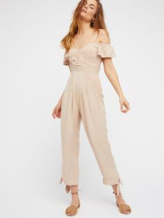 In The Moment Jumpsuit | Cute and easy jumpsuit with cut embroidered details featuring a shoulder-baring design with femme, flouncy sleeves.    * Open back * Hidden side zipper closure * Elastic at the back and sleeves * Ties at the hem * Half lined