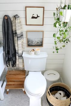 Chic, electric bathroom update featuring shiplap, single vanity, marble tile, and gold faucets. Come see the upstairs bathroom remodel with Nesting with Grace. #nestingwithgrace #bathroomdecor #bathroomupdate #diybathroom #marble