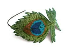 Peacock Feather Headband- Beautifully Unique Silk Fabric Embroidered Feather- Peridot Green with Sage Embroidery. $35.00, via Etsy.
