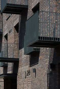 Image 10 of 48 from gallery of Rassvet Loft Renovation / DNK ag. Photograph by Ilya Ivanov Brick Arch, Brick Facade, Brick Wall, Stair Railing Design, Facade Design, Modern Exterior House Designs, Modern House Design, Scotland Street, House Deck
