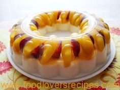 Ingredients For fruit jelly: 2 canned peaches, sliced 10 red grapes, halved and deseeded 300ml sugar syrup from canned peaches 1 ½ tsp gelatine A drop of vegetable oil For yogurt jelly: 500ml mango&vanilla flavoured yogurt 100ml milk 2 tsp sugar 15g gelatine We used a Tupperware Jel-Ring Mold, 24cm in diameter Making the fruit …