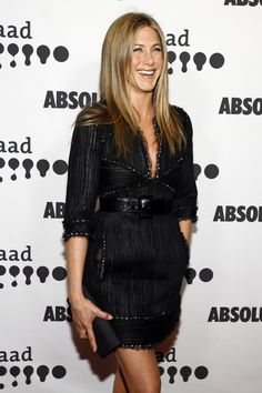 Wearing her signature color, Aniston embraced an edgier look in this shimmering little black dress from Chanel.