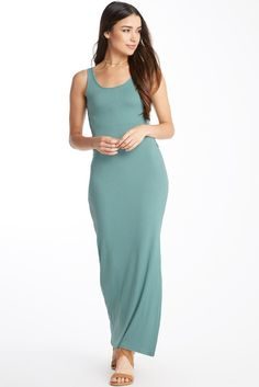 Knitted body conscious fabric features a fitted, sleeveless bodice that extends down the body to a maxi length, but not before showing off some leg with a high side slit. The high regard dress features a sexy side cutout with a peek of lace insert. This dress is unlined.