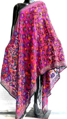 Steal the show at the next party you attend in this stunning phulkari work poly georgette dupatta. It has been heavily embroidered in a vibrant colored floral pattern, with wool thread and sequins - See more at: http://giftpiper.com/Handmade-Phulkari-Georgette-Dupatta-Magenta-id-245184.html#sthash.ueKDlKz5.dpuf