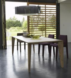 TRAPEZE. Solid wood table finished in walnut, treated with oil.