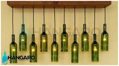 Diseño de lámpara con base de madera y botellas de vino. #Hangaro #Guatemala #CreacionChapina #Vidrio
