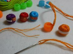 miniature ball of cotton thread - pony beads and embroidery floss